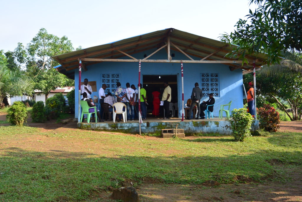 people lining up at a church in Africa