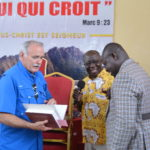 Chuck Ballard awards a bible to APT graduate